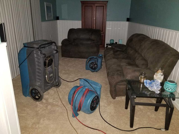 Water Damage Restoration set up in customers living room in Port Saint Lucie, Florida.